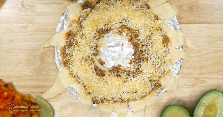 Give a twist to taco night by making a taco crescent ring. Taco filling baked into a crisp crescent roll dough, what could be better?
