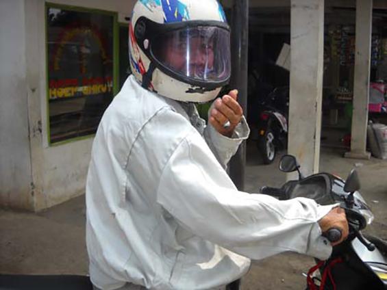 Rojak, one of the ojek drivers at Parung Bingung 3-way intersection