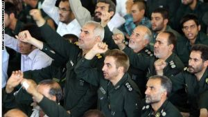 Members of the Iranian revolutionary guards shout anti-Israeli and anti-US slogans during the weekly Friday prayers at Tehran University in the Iranian capital on July 16, 2010. AFP PHOTO/ATTA KENARE (Photo credit should read ATTA KENARE/AFP/Getty Images)
