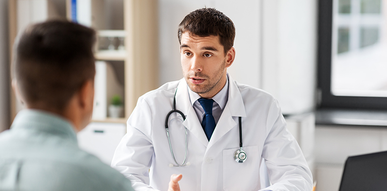 Doctor talking to his patient seriously