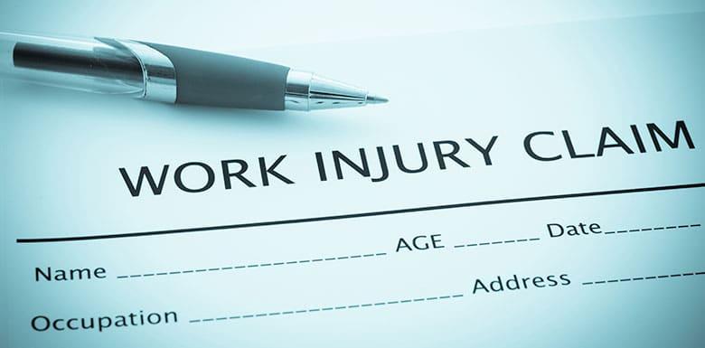 Work injury claim sheet and pen