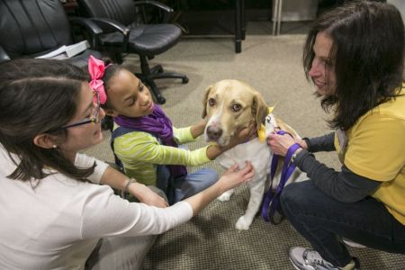 Lisa, a HIP volunteer, and her dog George take HIP's No More Bullies program to children at Big Brothers Big Sisters of Greater Birmingham.