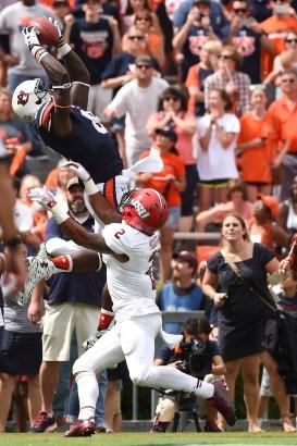 Auburn's Ray Melvin elevates for the football against Jacksonville State. (Zach Bland/Auburn Athletics)