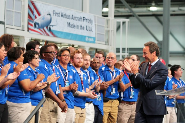 Fabrice Bregier, Airbus President and CEO, applauds Airbus employees at the grand opening. (Mike Kittrell/Alabama NewsCenter)