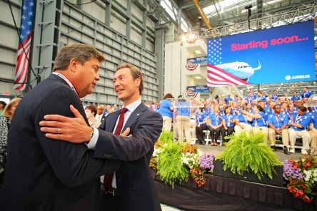 Fabrice Bregier, Airbus president and CEO, right, greets John L. Plueger, Air Lease Corporation President and CEO, at the grand opening ceremony of Airbus U.S. Manufacturing Facility on Monday, Sept. 14, 2015, in Mobile, Ala. (Mike Kittrell/Alabama NewsCenter)