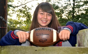 Mandy Davis poses with the game ball from her touchdown-scoring game. (Solomon Crenshaw Jr./Alabama NewsCenter)