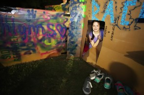 Madalyn O'Sullivan,11, of Mobile, Ala., a member of Dauphin Way United Methodist Church, participates in Cardboard City at Alabama School of Mathematics and Science on Saturday, Oct. 24, 2015, in Mobile. Participants sleep overnight in a cardboard box and dine from a soup line to connect with the struggle of homelessness. This event helps build public awareness of local homelessness and benefits Family Promise of Coastal Alabama and Dumas Wesley Community Center. (Mike Kittrell)