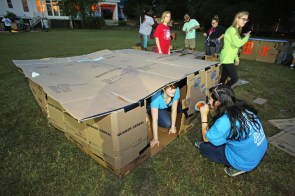 Danyelle Adams,19, of Mobile, Ala., inside box, and other members of Forest Hill United Methodist Church participate in Cardboard City at Alabama School of Mathematics and Science on Saturday in Mobile. (Mike Kittrell/Alabama NewsCenter)