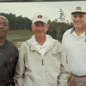 Baker is joined by former Auburn University head football coach Tommy Tuberville (c). Tuberville is currently the head football coach at the University of Cincinnati.