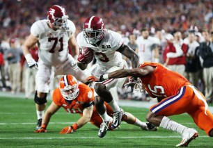 Crimson Tide receiver Calvin Ridley avoids a tackle. (Kent Gidley/UA Athletics)