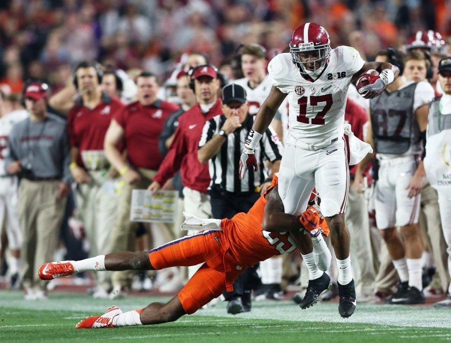 Crimson Tide running back Kenyan Drake tries to escape a tackle. (Kent Gidley/UA Athletics)