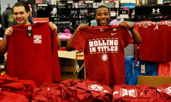 Academy Sports staffers show off some of the merchandise. (Solomon Crenshaw Jr./Alabama NewsCenter)