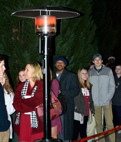 Academy Sports provided heat lamps to fight off the bitter cold for those waiting in line. (Solomon Crenshaw Jr./Alabama NewsCenter)