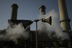 Steam rises in front of stacks