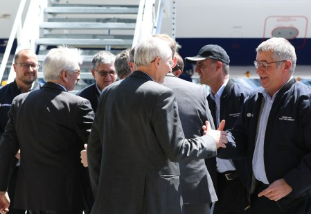 Airbus officials welcome the flight crew after landing. (Mike Kittrell/Alabama NewsCenter)