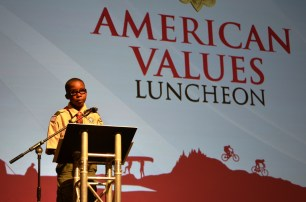 Boy Scout Zachary Graham speaks at the luncheon. (Michael Tomberlin/Alabama NewsCenter)