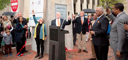 Officials toast the lighting and dedication of the Rotary Trail sign. (Christopher Jones/Alabama NewsCenter)