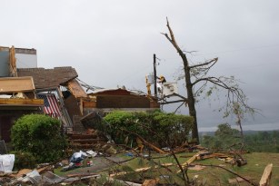 Southern Co. crews work to restore service in Alabama communities following the deadly tornadoes of April 27, 2011. This is Pratt City.