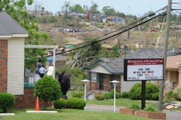 A church announces its first service following the deadly tornadoes of April 27, 2011.