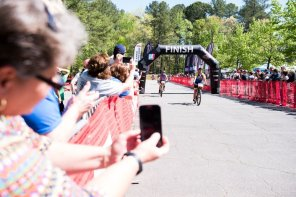 Parents and supporters capture images in cycling competition. (Nik Layman/Alabama NewsCenter)