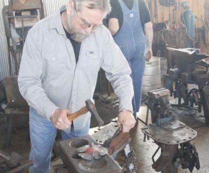 Blacksmiths at work, displaying their craft. (contributed)