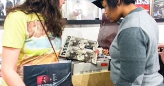 Shoppers consider an old album by The Smiths at SeasicK Records. (Jaysen Michael/Secret Playground)