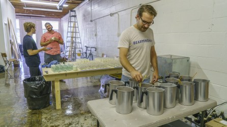 Jake Carnley and his partners in their Birmingham workshop at Great Bear Wax Co. (Mark Sandlin/Alabama NewsCenter)