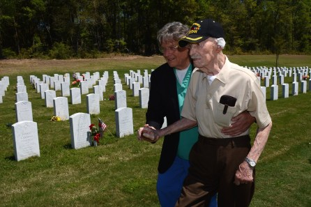 Barry Booth assists John Jacobson in, 105, in walking to his wife's grave at the Alabama State Veterans Memorial Cemetery at Spanish Fort. (Karim Shamsi-Basha)