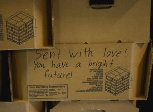 Food boxes include special messages of love and hope for recipients. (Karim Shamsi-Basha/Alabama NewsCenter)
