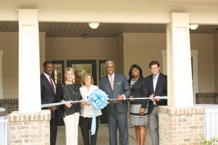 Birmingham Mayor William Bell and other officials cut the ribbon on the Park at Wood Station townhouse development in Woodlawn on May 9. (Joe Rada/Regions Bank)