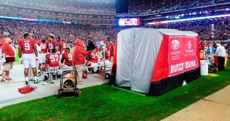 The SidelinER, a medical tent developed at the University of Alabama, stands on the sideline during the Crimson Tide's 2015 game with LSU. In just three seasons, the invention has proven extremely popular among college and pro football teams.