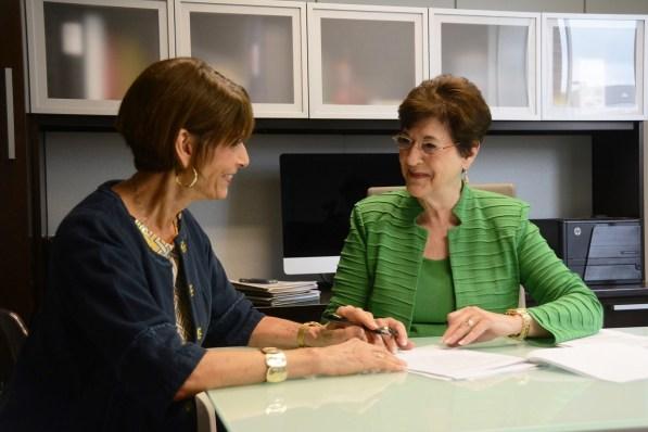 June Henton, right, talks with a key partner in her efforts against world hunger, Hunger Solutions Institute Director Harriet Giles. (Karim Shamsi-Basha/Alabama NewsCenter)