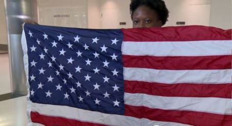 Jayla holds up American flag after winning the bronze medal last year at IAAF World Youth Championships in Colombia. (Alabama NewsCenter)