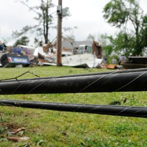 In the distance, Alabama Power crews during storm restoration. (file)