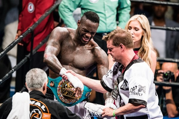 Deontay Wilder grimaces as manager/trainer Jay Deas examines his hand. Wilder bent the pins in his hand and tore a muscle in his right bicep, effectively making him a one-armed fighter the last four rounds. (Nik Layman/Alabama NewsCenter)