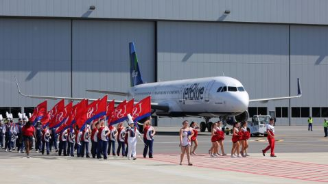 The University of South Alabama Jaguar Marching Band creates a pep rally atmosphere to a delivery ceremony April 25 for the first Airbus aircraft produced at Airbus U.S. Manufacturing Facility in Mobile. (Mike Kittrell/Alabama NewsCenter)