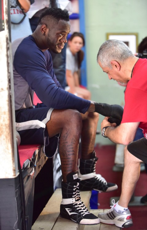Wilder has his hands wrapped by assistant trainer Russ Anber before a workout. (Frank Couch / The Birmingham Times)