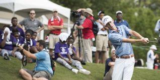 A golfing pro takes a swing. (Christopher Jones/Alabama NewsCenter)