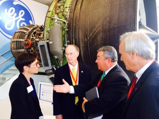 Gov. Bentley and Commerce Sec. Canfield speak to GE Aviation executive Colleen Athans at the 2014 Farnborough Airshow. (contributed)