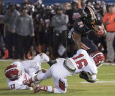 Hoover High player attempts to break a tackle. (Bernard Troncale/Alabama NewsCenter)