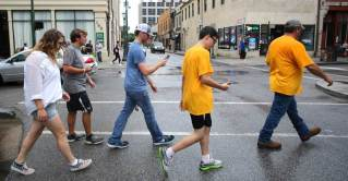Fans play Pokémon Go in Mobile during an event organized to draw players into the city's business district. (Mike Kittrell/Alabama NewsCenter)