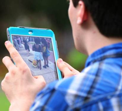 A fan plays Pokémon Go in Mobile during an event organized to draw players into the city's business district. (Mike Kittrell/Alabama NewsCenter)