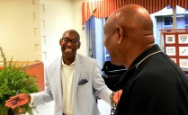 Roderick Royal welcomes a fan at a book signing. (Solomon Crenshaw Jr./Alabama NewsCenter)