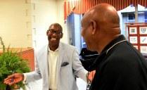 Roderick Royal welcomes a fan at a book signing. (Solomon Crenshaw Jr./Alabama NewsCenter)