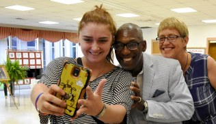 Roderick Royal takes a selfie with Birmingham City Councilwoman Kim Rafferty, right, and her daughter Jessica Rafferty. (Solomon Crenshaw Jr./Alabama NewsCenter)