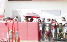 Fans watch practice prior to Fan Day. (Amelia B. Barton / UA Athletics)
