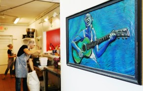 Colin Woltmann's and Allie Clark's love of music is on display in their company's Athens kitchen as well as on their product labels. (Mark Sandlin/Alabama NewsCenter)