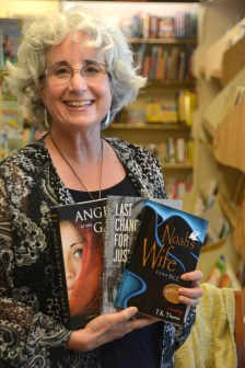 T.K. Thorne holds copies of her three books. Thorne loves to share what she has learned with other Alabama writers. (Karim Shamsi-Basha/Alabama NewsCenter)