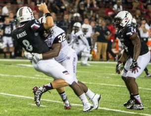 Byran Brower delivers a sack. Brower is a special player and defensive leader for Alabama A&M. (Alabama A&M Athletics)