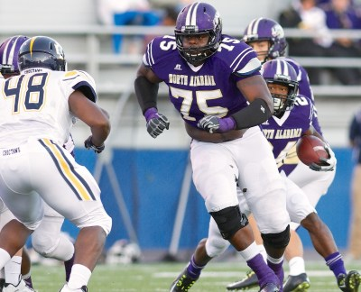 Stephen Evans, a key returning starter on UNA's offense this year, delivers a block for North Alabama running back Lamonte Thompson. (UNA Athletics)